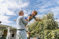 Father playing with son in garden - DIGF08175
