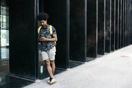 Man using smartphone outdoors, Barcelona, Spain - JRFF03688