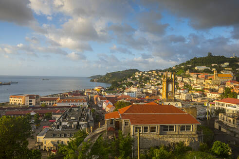 Aerial view of St. George's town by sea against sky at sunset, Grenada, Caribbean - RUNF02984