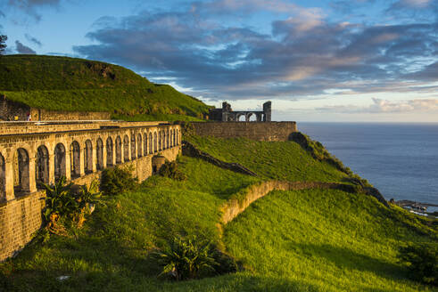 Brimstone hill fortress by sea against sky, St. Kitts and Nevis, Caribbean - RUNF03029