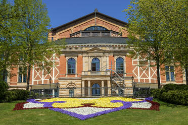 Colorful flowers growing in front of Bayreuth Festspielhaus during sunny day, Bayreuth, Germany - LBF02705