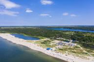 Aerial view of lake on coast of Yantarny by beach against sky, Kaliningrad, Russia - RUNF03037