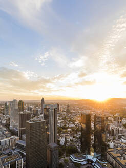 Cityscape against cloudy sky during sunset, Frankfurt, Hesse, Germany - WDF05490
