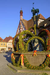 Osterbrunnen in front of town hall against clear blue sky, Forchheim, Germany - LBF02718