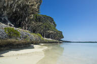 The grey Lekiny cliffs against blue sky, Ouvea, Loyalty Islands, New Caledonia - RUNF03064