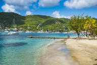 Scenic view of town beach at Port Elizabeth, Admiralty Bay, Bequia, St. Vincent and the Grenadines, Caribbean - RUNF03078