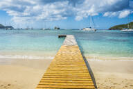 Pier against cloudy sky at Admiralty Bay, Bequia, St. Vincent and the Grenadines, Caribbean - RUNF03081