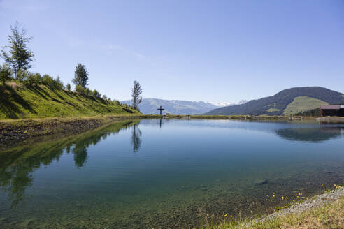 Scenic view of Astbergsee lake against clear sky at Astberg, Kitzbühel, Tyrol, Austria - WIF04036