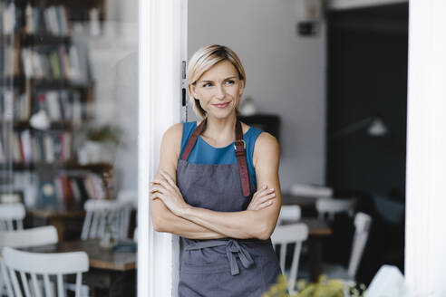 Business owner standing in front of her coffee shop - KNSF06319