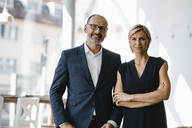 Portrait of confident businessman and woman - KNSF06346