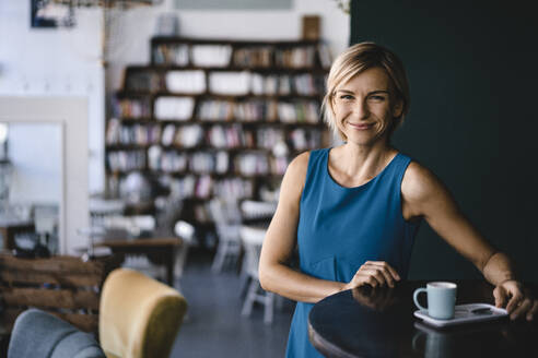 Business woman relaxing with a cup of coffee - KNSF06391