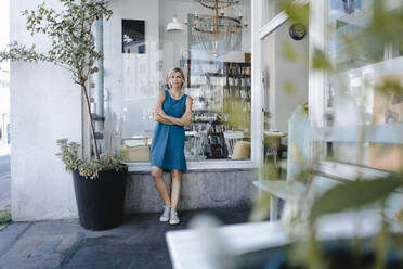 young business owner, standing in front of her coffee shop - KNSF06400