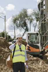 Architect using phone on construction site - AHSF00820