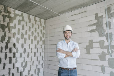 Portrait of architect on construction site - AHSF00838