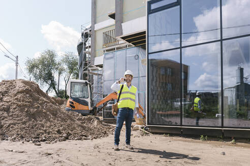 Architect using phone on construction site - AHSF00841
