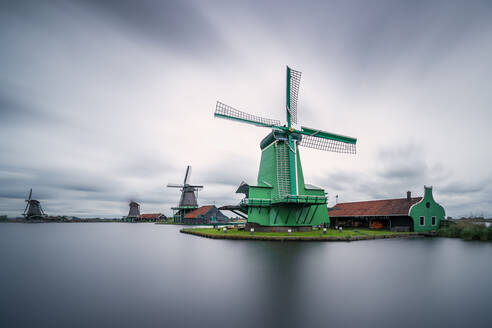 De Gekroonde Poelenburg by Zaan river against sky at Zaanse Schans, Zaandam, Netherlands - XCF00201