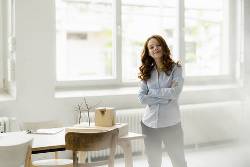 Portrait of redheaded woman with architectural model in a loft - KNSF06441