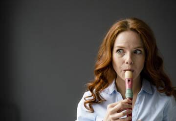Portrait of redheaded woman playing recorder - KNSF06444