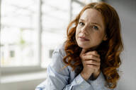 Portrait of redheaded businesswoman in a loft - KNSF06447