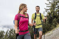 Confident young couple on a hiking trip in the mountains, Herzogstand, Bavaria, Germany - DIGF08284