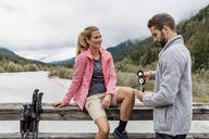 Young couple having a break during a hiking trip, Vorderriss, Bavaria, Germany - DIGF08356
