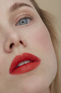 Woman's face with made up red lips, close-up - PGCF00014