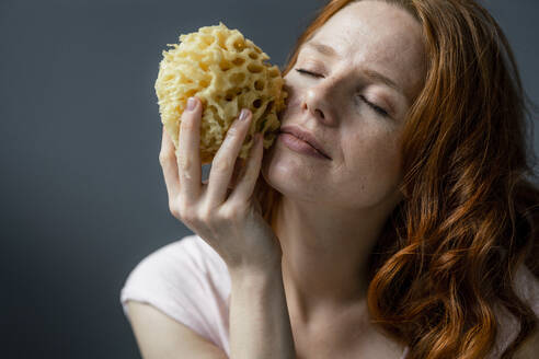 Portrait of redheaded woman with natural sponge - KNSF06505