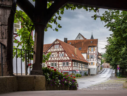 Exterior of half-timbered houses by street, Strümpfelbach, Baden-Württemberg, Germany - STSF02237