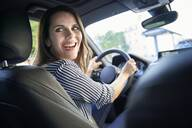 Happy woman driving car - PNEF01972