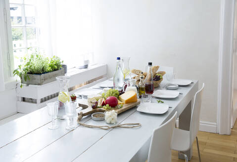 Laid table with fruit, cheese and bread - MJFKF00105