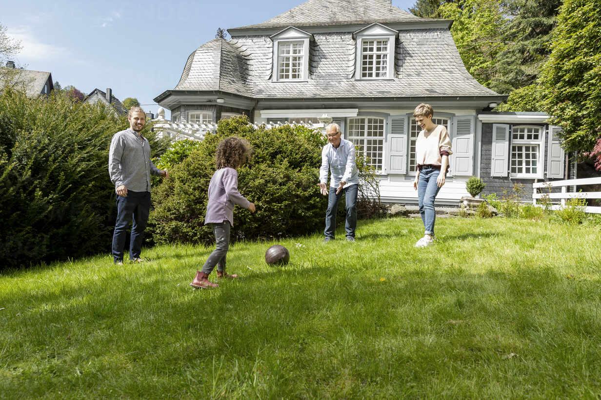Happy extended family playing football in garden - MJFKF00132 - MiJo/Westend61
