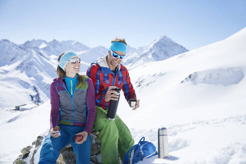 Happy youple of ski tourers having a break in the mountains, Kuehtai, Tyrol, Austria - CVF01508