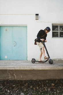 Man with Electric Scooter - PSIF00316