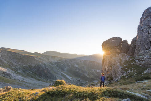The last rays of sun disappear behind a rock face after a day of trekking in the Rila Mountains, Bulgaria, Europe - RHPLF09256