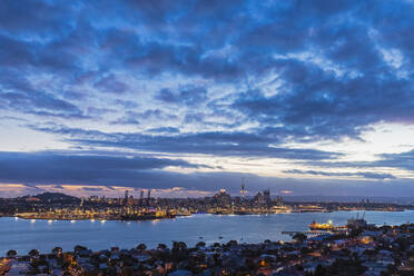 Modern buildings by sea against cloudy sky at dusk in Auckland, New Zealand - FOF10890