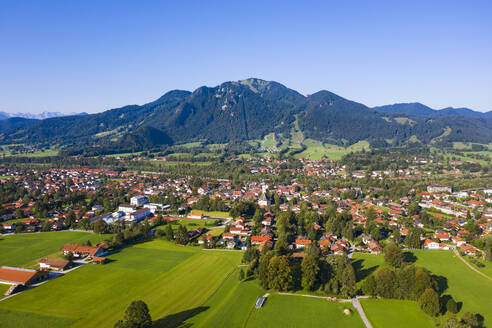 Aerial view of Lenggries with Brauneck against clear blue sky, Bavaria, Germany - LHF00710