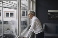 Senior businessman looking out of the window - GUSF02567