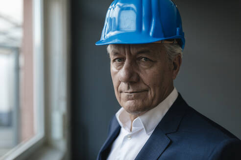 Portrait of a confident senior businessman wearing hard hat - GUSF02600