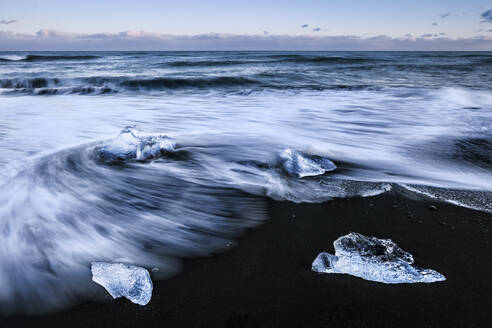 Scenic view of icebergs in sea against sky during sunset, Jokulsarlon, Iceland - XCF00209