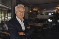 Portrait of senior businessman in a cafe - GUSF02626