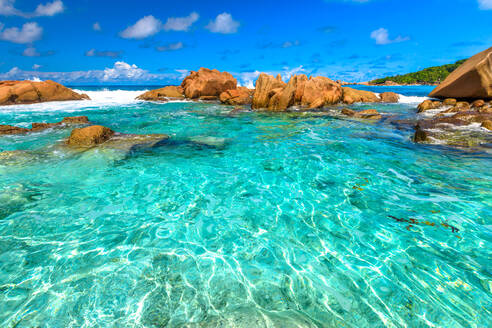 Turquoise sea of natural pool, clear calm waters of swimming pools at Anse Cocos near Grand Anse and Petite Anse protected by rock formations, La Digue, Seychelles, Indian Ocean, Africa - RHPLF10308