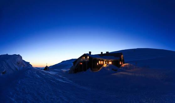 Illuminated house at winter - JOHF00382