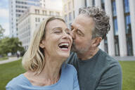 Happy mature couple kissing in the city - RORF01921