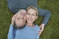 Top view of happy mature couple lying in grass - RORF01930