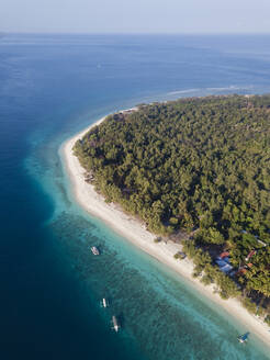 Drone shot of Gili Meno island against clear sky at Bali, Indonesia - KNTF03423