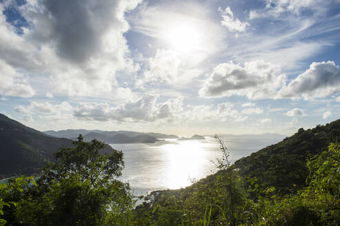 Scenic view of British Virgin Islands against cloudy sky during sunny day - RUNF03134