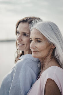 Mother and daughter spending a day at the sea, portrait - JOSF03659
