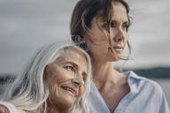 Mother and daughter spending a day at the sea, portrait - JOSF03668