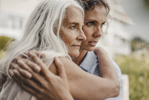 Mother and daughter embracing in nature, portrait - JOSF03677