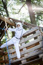 young, cool boy dressed as a superhero astronaut playing in a beautiful, tree house in the afternoon sun, lower austria, austria - HMEF00539